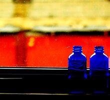 Bottles on a ledge by Wojtek  Jaskiewicz