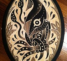 Tangled squid on wood by Elizabeth Dibois
