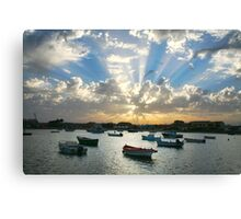 Boats on the sea and rays of light  Canvas Print