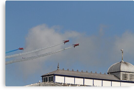 The Red arrows fly over the pier at Airbourne in Eastbourne by Keith Larby