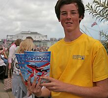 A programme seller at Airbourne in Eastbourne by Keith Larby