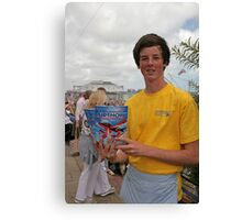 A programme seller at Airbourne in Eastbourne Canvas Print