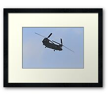 A chinook helicopter displays at Airbourne in Eastbourne Framed Print