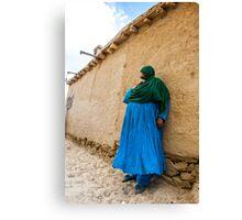 Afghan Woman against a wall Canvas Print