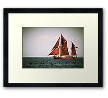 Yacht with brown sails Framed Print