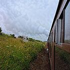 Steam train coach reflection by Avril Harris