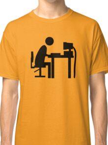 Man sitting at an office desk. Classic T-Shirt