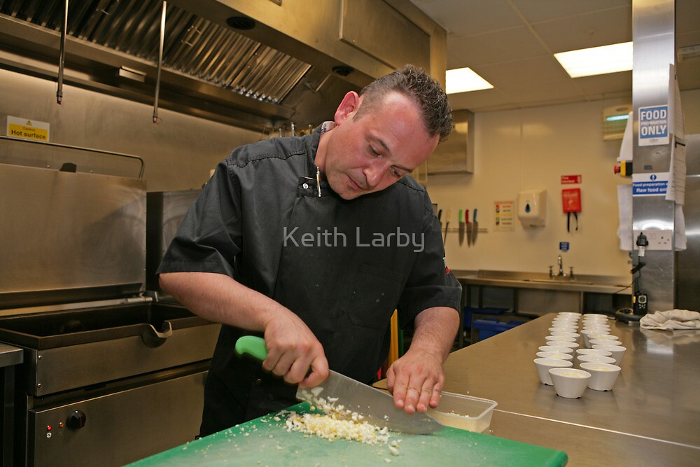 Chef prepares boiled eggs at Tapas Revolution by Keith Larby