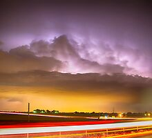 25 to 34 Intra-Cloud Lightning Golden Light Car Trails by Bo Insogna