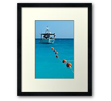 Sea, sky, boat and buoys Framed Print