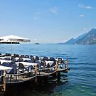 Dining at lake Garda in Malcesine - Italy by Arie Koene