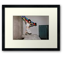 A Woman Jumping on Her Bed Framed Print