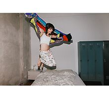 A Woman Jumping on Her Bed Photographic Print