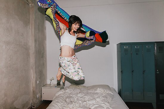 A Woman Jumping on Her Bed by visualspectrum