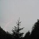 lightning bolt over the hill by LoreLeft27