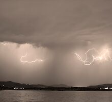 Lightning and Sepia Rain Over Rocky Mountain Foothills by Bo Insogna