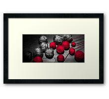 Red balls of thread Framed Print