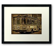 A trolley ride thru the square Framed Print