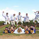 The grooms men jump by Carl LaCasse