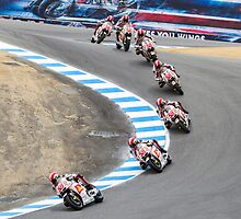 Marco Simoncelli going down the corkscrew at laguna seca 2011 by corsefoto