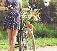 Woman With Old-Fashioned Bicycle and Flowers by visualspectrum