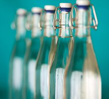 Row of Glass Bottles by visualspectrum
