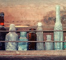 Old bottles by Laura Sykes