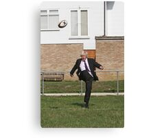 Boris Johnson kicking a rugby ball at streatham-croydon R.F.C. Canvas Print