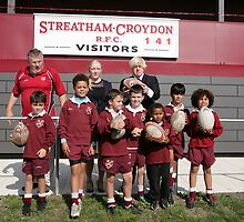 Boris Johnson poses with kids at streatham-croydon R.F.C. by Keith Larby