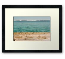 Looking off the Pier Framed Print