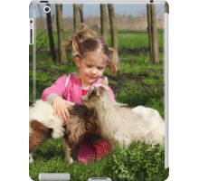 child play with two little goats iPad Case/Skin