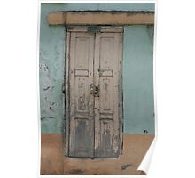 Weathered Door in a Blue Wall Poster