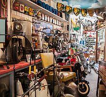 A vintage shop of Old Vespas in Paris France by glymps