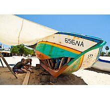 Beach boat repair Photographic Print