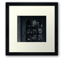 the cabinet Framed Print