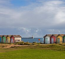 Beach huts with a view of Blyth Pier by David Patterson