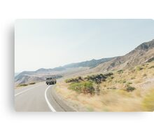 Camper Van Driving Through Dry Landscape Canvas Print