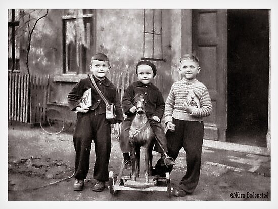Three boys and a horse on wheels by © Kira Bodensted