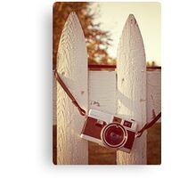 Vintage film camera on picket fence Canvas Print
