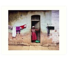 Woman In Front Of The House Art Print