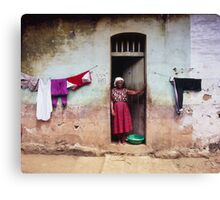 Woman In Front Of The House Canvas Print