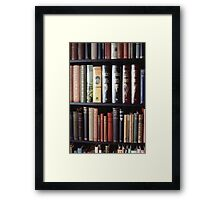 Books on a bookshelf Framed Print