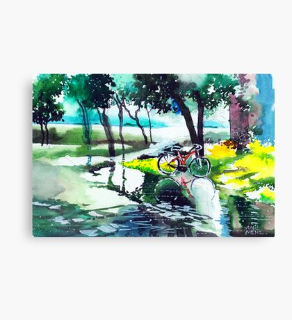Cycle in puddle Canvas Print