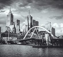 Moody Melbourne from the South Bank of the Yarra River by jamjarphotos