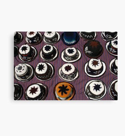 Knit Hats on a Rug Canvas Print