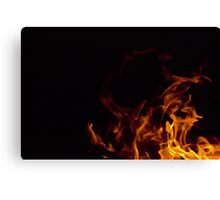 Flames in the dark Canvas Print