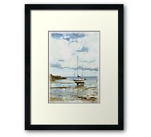 Yacht standing on a sandy beach  Framed Print