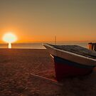 Boats at sunrise by DavidCucalon