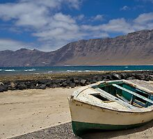 Little wooden boat on the beach by Judi Lion
