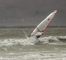 Sun glinting on a windsurfer by Judi Lion